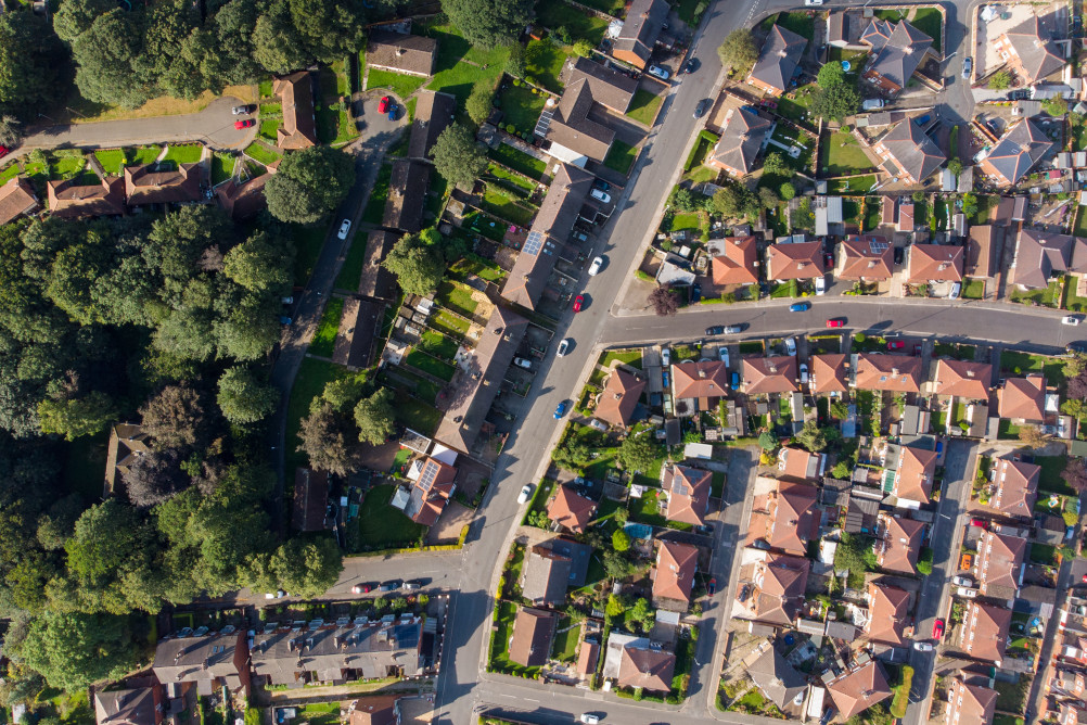 An aerial view of a neighbourhood in the UK illustrating the importance of community care and statutory funding after major trauma