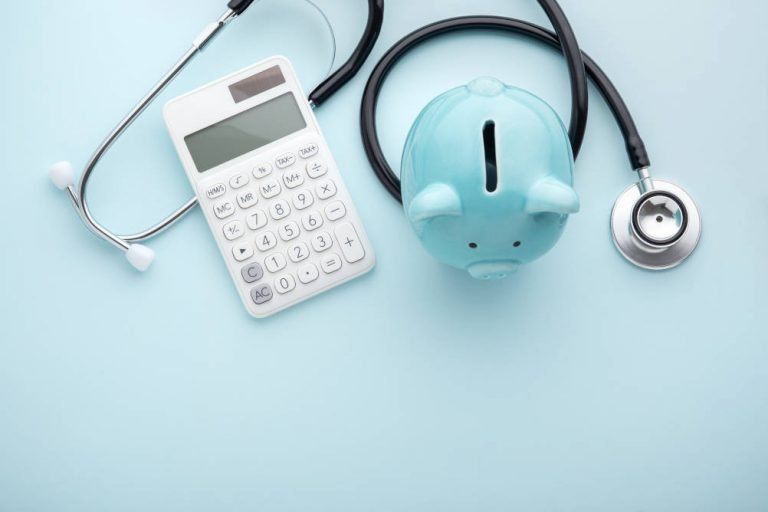 A stethoscope, calculator and piggy bank illustrate our overview and top tips for Continuing Healthcare Funding